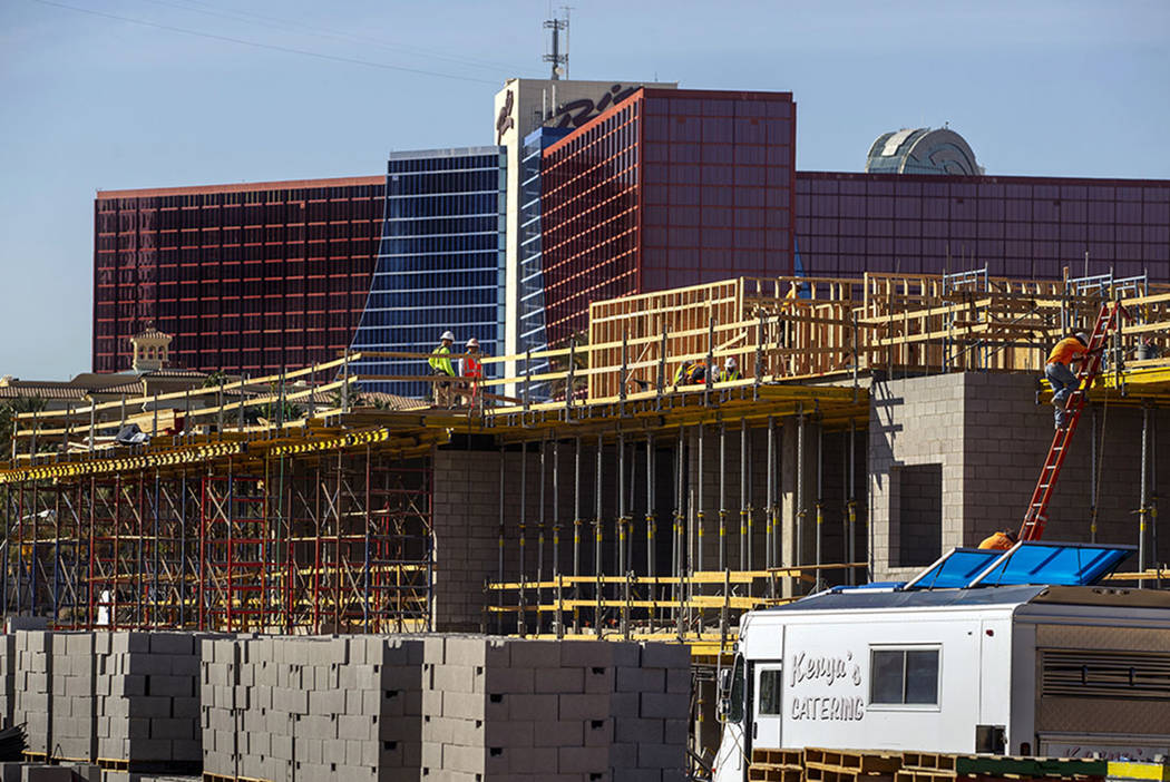 Framers continue on a new apartment complex by developer Jonathan Fore currently under construc ...