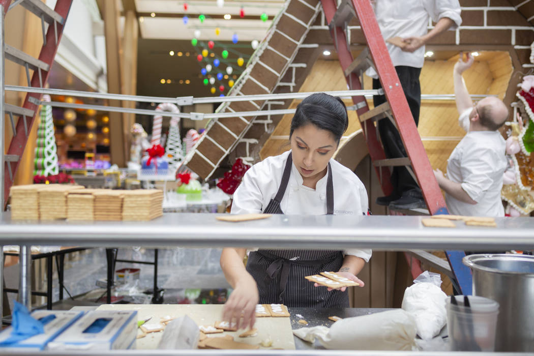 Aria Patisserie assistant pastry chef Andrea Madrid uses graham cracker and icing for the entry ...