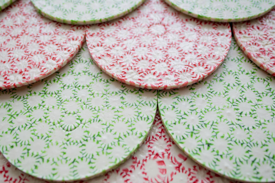 Peppermint disks act as the shingles for a giant gingerbread house in the lobby of the Aria res ...