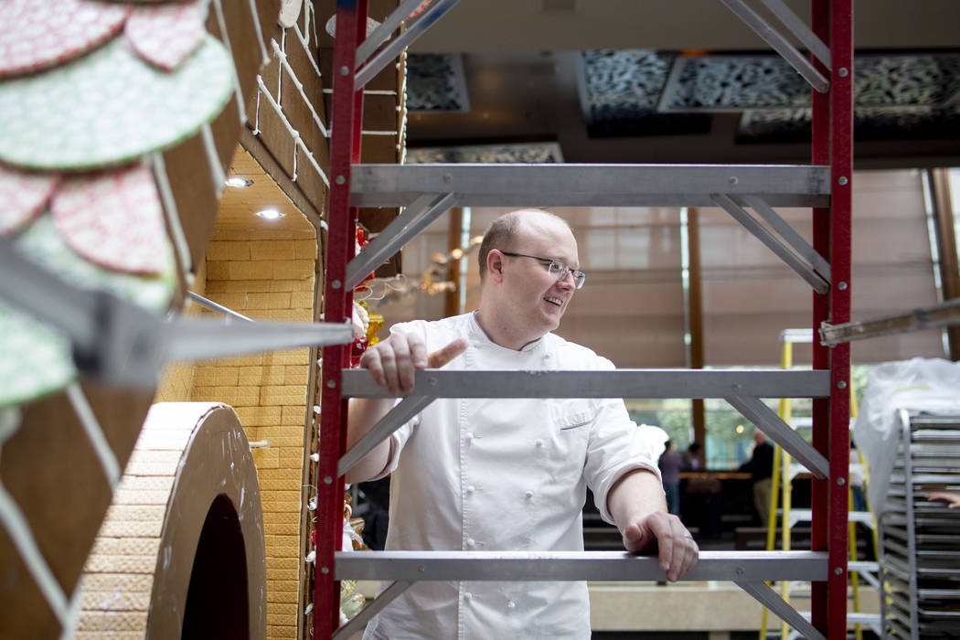 Aria Patisserie pastry chefs work on a giant gingerbread house in the lobby of the Aria resort- ...