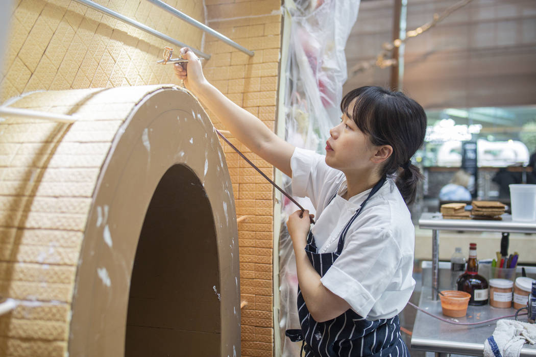 Aria Patisserie pastry chef Sunny Lee uses a liquor apricot luster to give shine to a graham cr ...