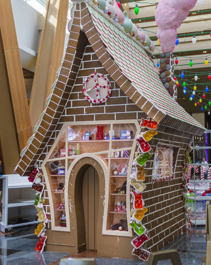 A giant gingerbread house in underway made by Aria Patisserie pastry chefs in the lobby of the ...