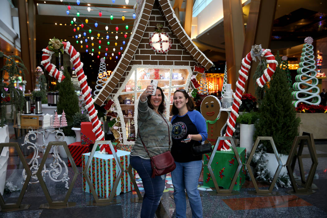 Paula Dymond of Toronto, left, and Jen Jakubowicz of Philadelphia pose in front of a 15-foot-ta ...