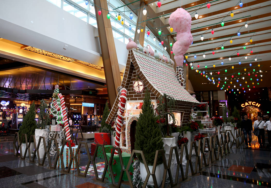 A 15-foot-tall gingerbread house in the lobby of Aria in Las Vegas Monday, Nov. 18, 2019. The t ...