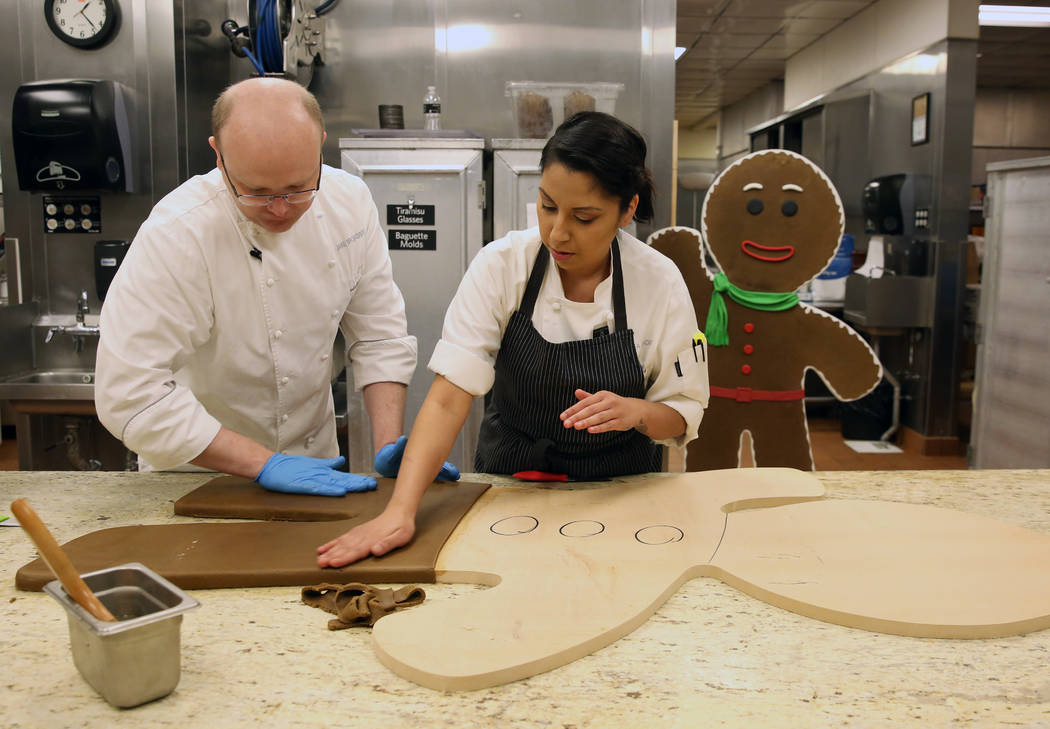 Jake Broadbent, left, assistant executive pastry chef at ARIA resort-casino, left, and Andrea M ...