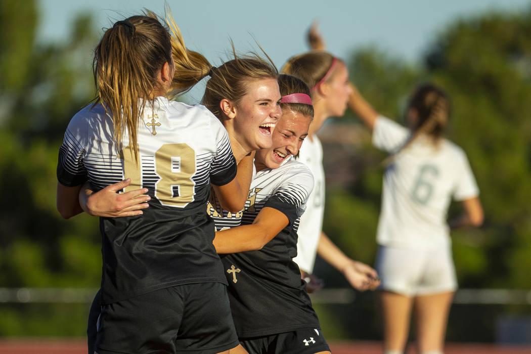 Faith Lutheran's Amelia McManus (20, center) celebrates a goal with teammates Addy Radwanski (1 ...