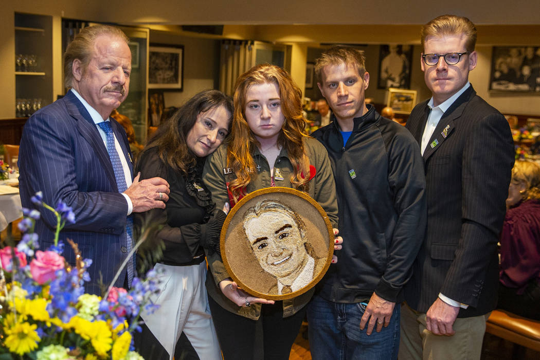 The Jimmerson family gather with the completed floragraph of Jacob Jimmerson who is being honor ...