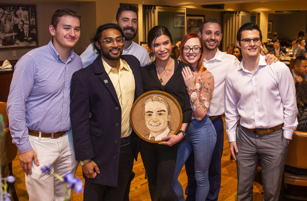 Close friends gather with the completed floragraph of Jacob Jimmerson who is being honored wit ...