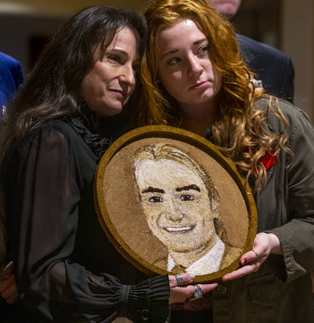 Carol, left, and Bentley Jimmerson pose with a floragraph of family member Jacob Jimmerson who ...