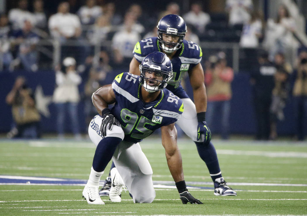 Seattle Seahawks defensive end Dion Jordan (95) and linebacker Bobby Wagner (54) line up agains ...
