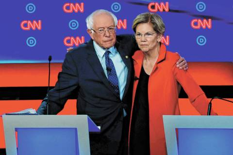Sen. Bernie Sanders, I-Vt., and Sen. Elizabeth Warren, D-Mass., embrace after the first of two ...