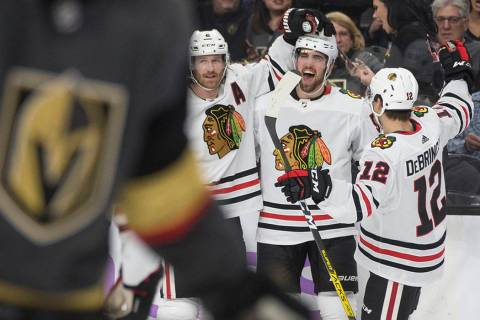 Chicago Blackhawks defenseman Erik Gustafsson, second from right, celebrates with Chicago Black ...