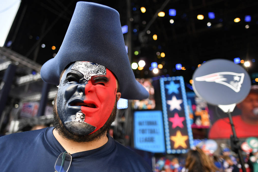 New England Patriots fan Derek Breton, of Huntsville, Ala., stands on the main stage ahead of t ...