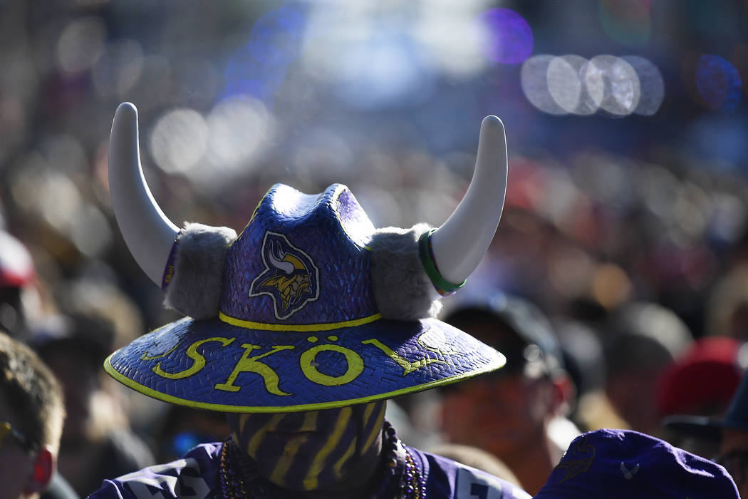 A Minnesota Vikings fan stands near the main stage ahead of the second round of the NFL footbal ...