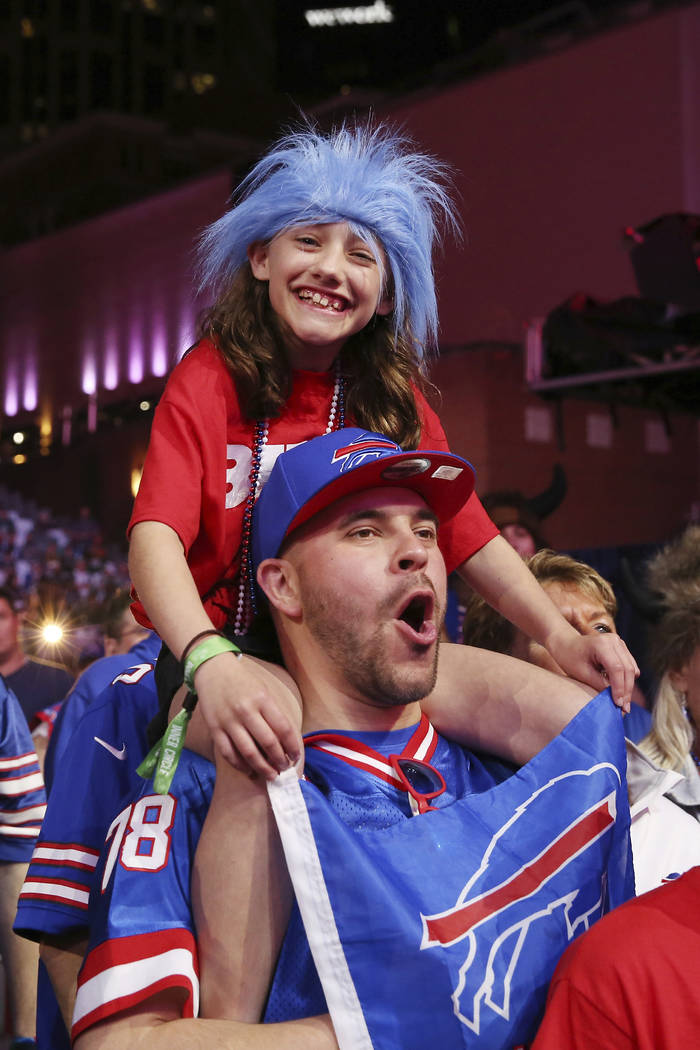 Fans cheer on the main stage during the second round of the NFL football draft, Friday, April 2 ...