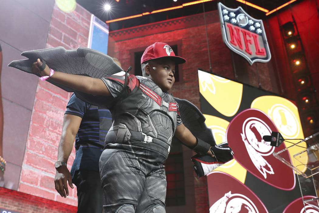 A young Atlanta Falcons fan poses on the main stage during the sixth round of the NFL football ...