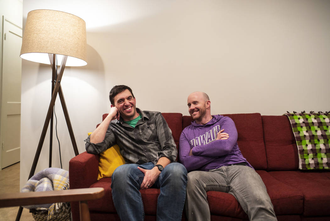 Ely Mayor Nathan Robertson, left, with his partner, Shadrach Michaels, at their home in Ely on ...