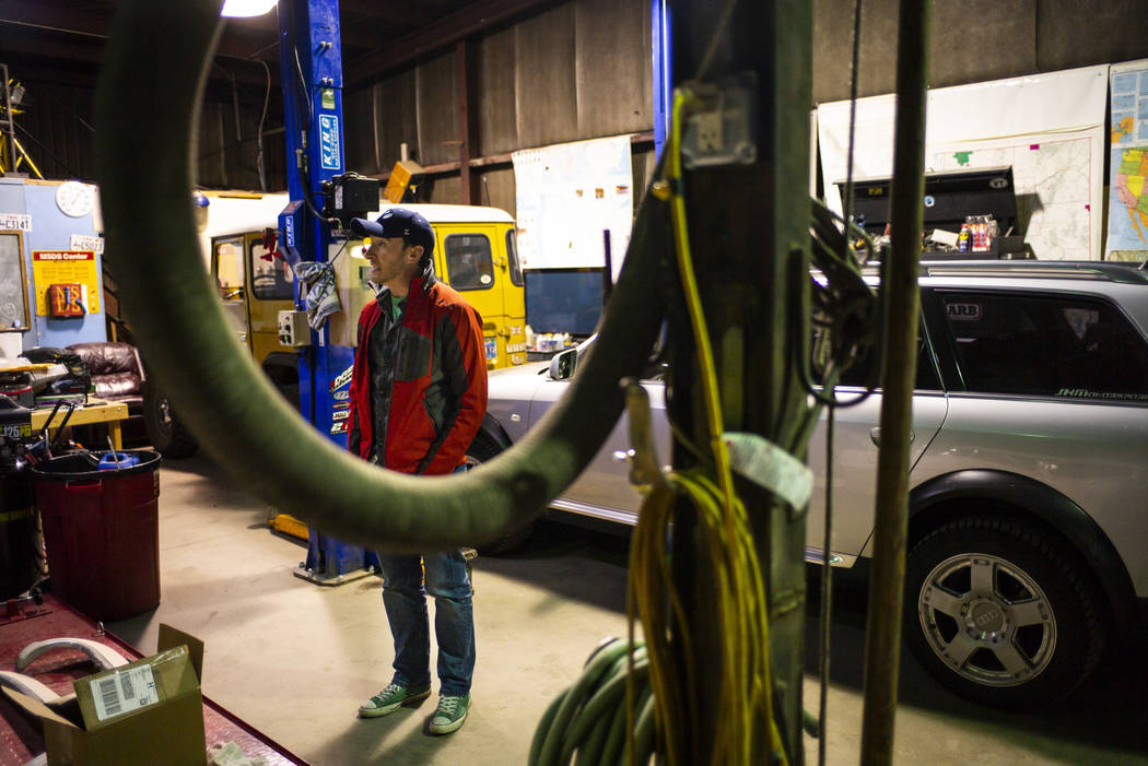 Ely Mayor Nathan Robertson talks about his garage, where he works on restoring vehicles, in Ely ...