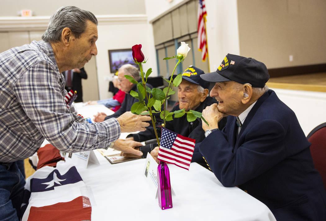 Korean War veteran Sammy Liguori, left, talks with World War II veterans Harry Galati, center, ...