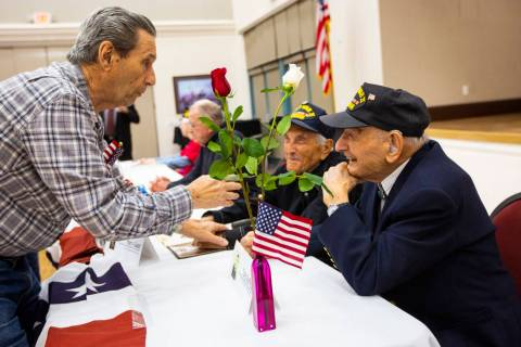 Korean War veteran Sammy Liguori, left, talks with World War II veterans Harry Galati, center, ...