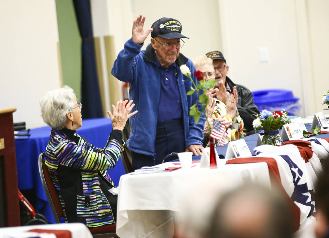 George Pantages, who served in the Navy aboard the USS Princeton, center, is introduced during ...