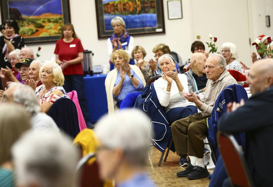 Attendees clap during an event honoring World War II veterans at the Desert Vista Community Cen ...