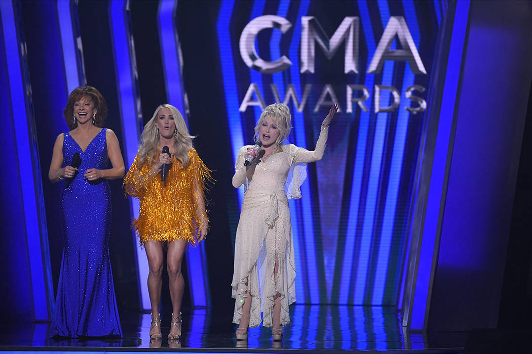 Hosts Reba McEntire, from left, Carrie Underwood and Dolly Parton appear at the 53rd annual CMA ...