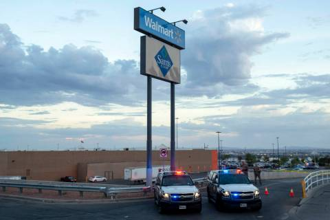 An Aug. 3, 2019, file photo, shows Texas state police cars blocking access to the Walmart store ...