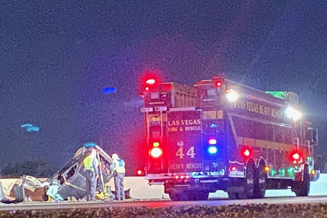 A blue sedan is overturned next to the median wall on Interstate 15 northbound between Lake Mea ...