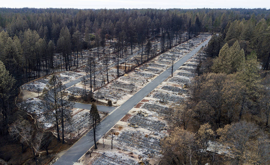 FILE - In this Dec. 3, 2018, file photo, homes leveled by the Camp Fire line the Ridgewood Mobi ...