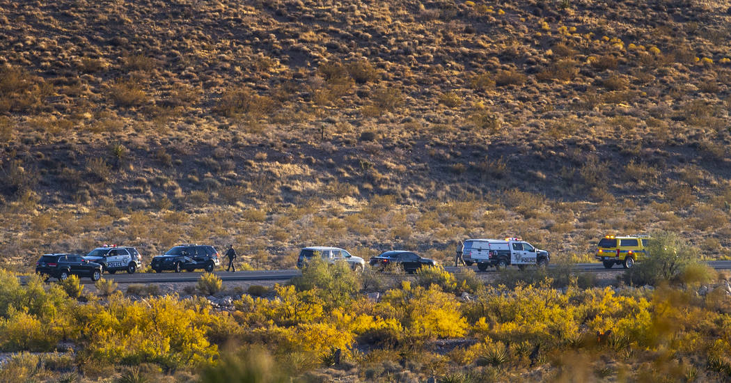 Emergency vehicles line state Route 159 in response to a helicopter crash near Red Rock Canyon ...