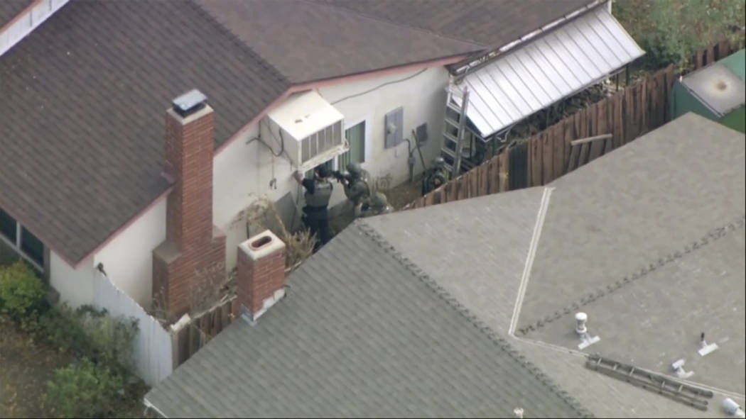 Police search a home in connection with shooting at Saugus High School on Thursday, Nov. 14, 20 ...