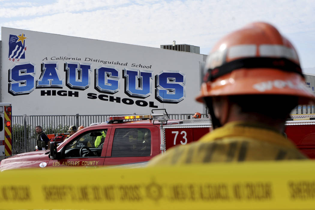 First responders standby for any injured students after a gunman opened fire at Saugus High Sch ...