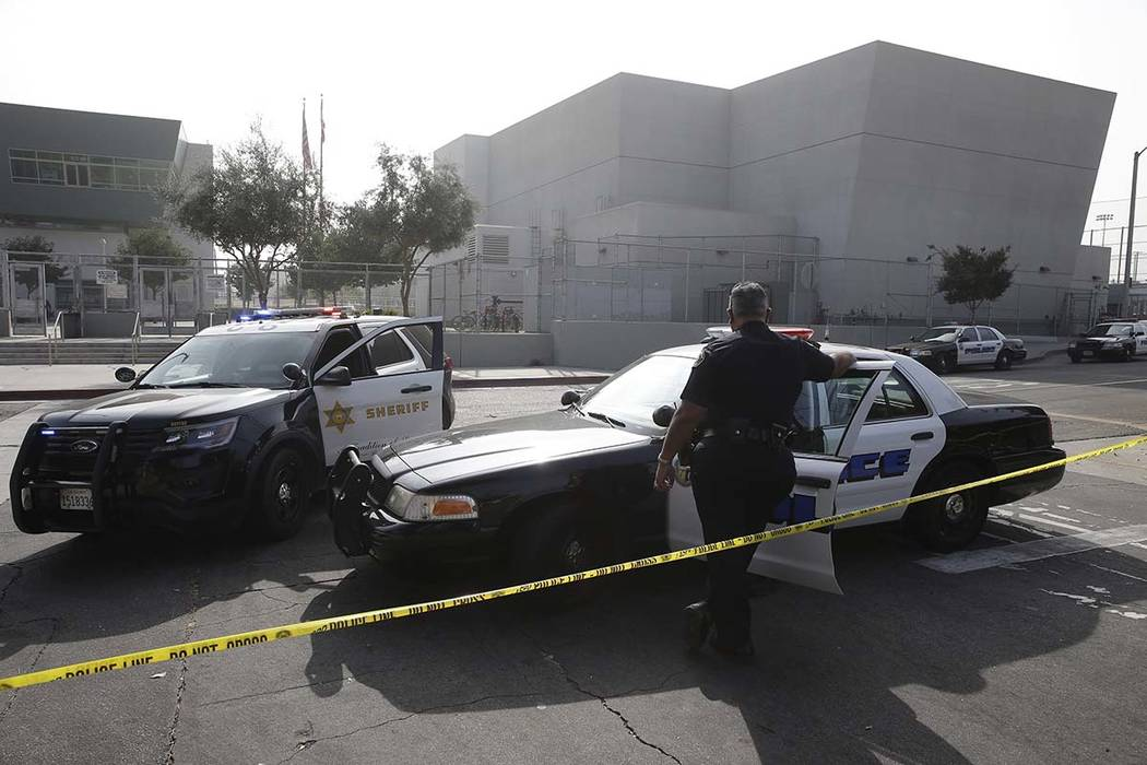 Los Angeles Sheriffs officers and school police guard the campus of Esteban Torres High School ...