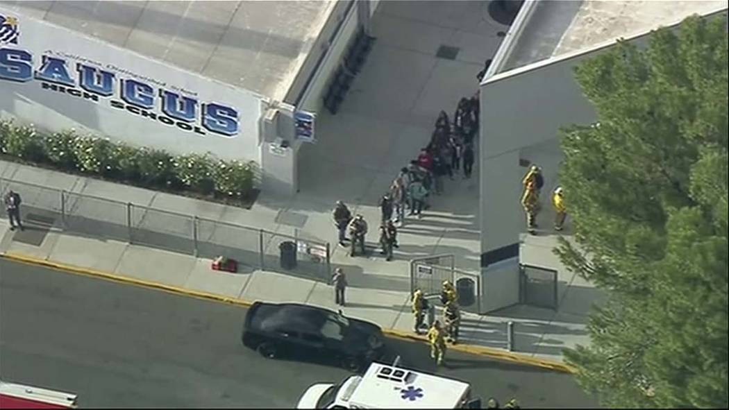 People are lead out of Saugus High School after reports of a shooting on Thursday, Nov. 14, 201 ...
