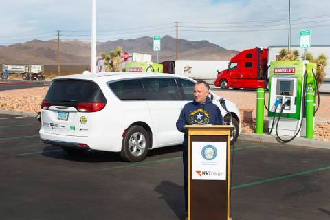 Assemblyman Chris Brooks gives remarks ahead of two DC fast electric vehicle chargers going liv ...
