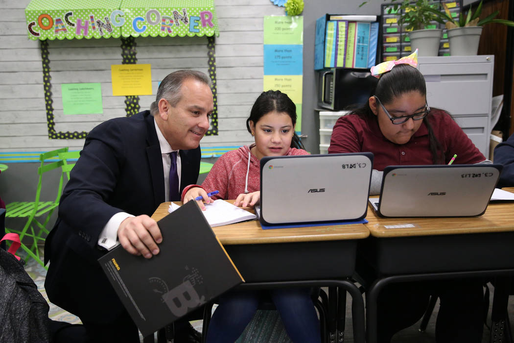 Clark County School District Superintendent Jesus Jara, from left, looks at the work by fifth-g ...