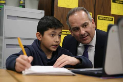 Fifth-grade-student Justin Lopez, 11, works on his math as Clark County School District Superin ...