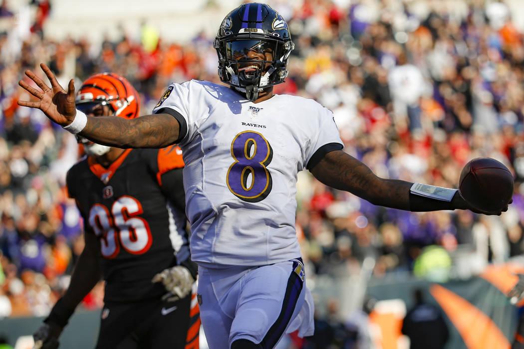 Baltimore Ravens quarterback Lamar Jackson (8) celebrates his touchdown during the second half ...