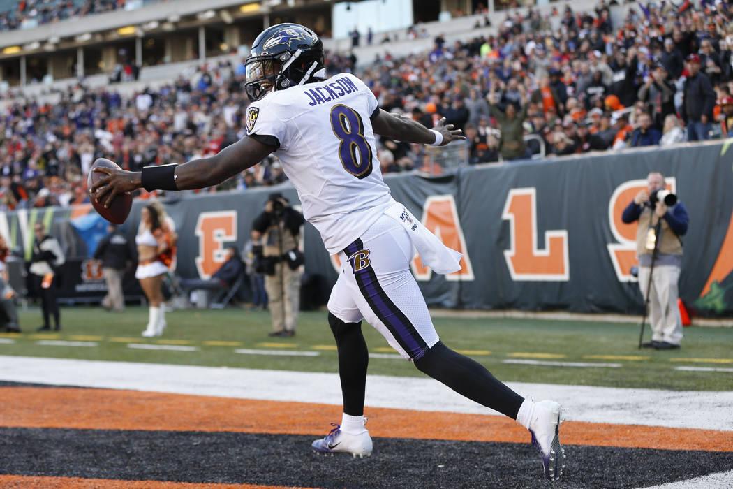 Baltimore Ravens quarterback Lamar Jackson celebrates his touchdown during the second half of N ...