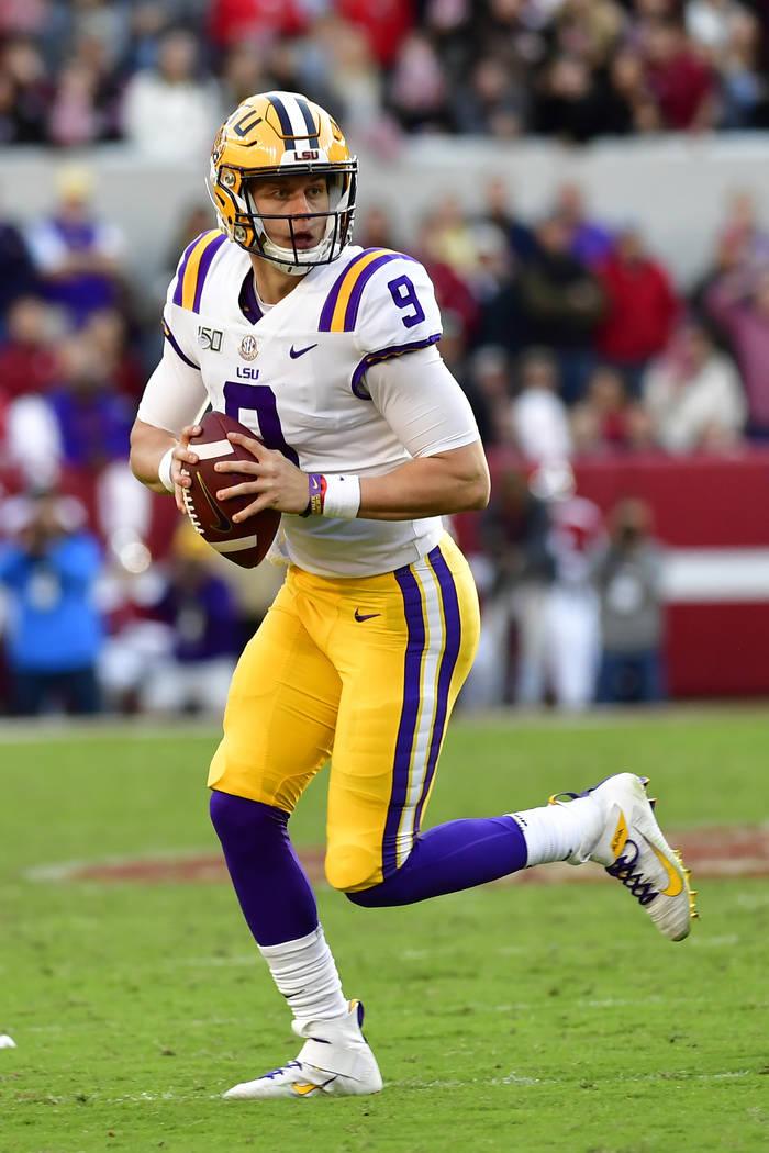 LSU quarterback Joe Burrow (9) looks for an open receiver in the first half of an NCAA football ...