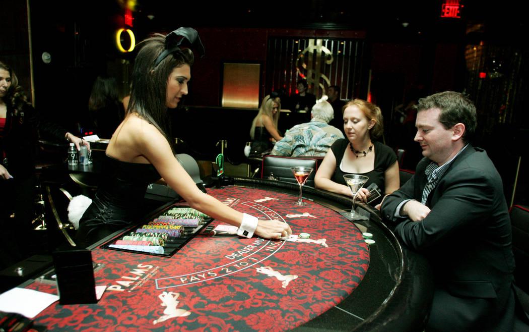 Playboy Bunny dealer Jessica Pagnoni, left, gives blackjack player Steve Lockett of Ashville, N ...
