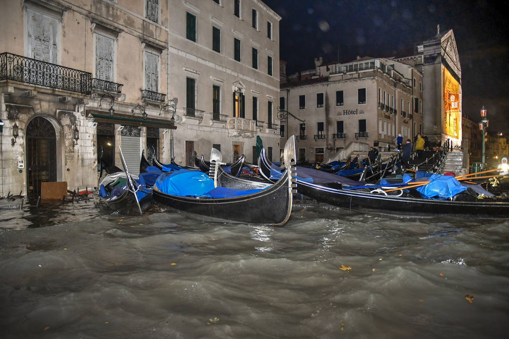Stranded gondolas float adrift over the flooded banks, in Venice, Wednesday, Nov. 13, 2019. The ...