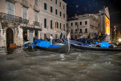 Stranded gondolas float adrift over the flooded banks, in Venice, Wednesday, Nov. 13, 2019. The ...