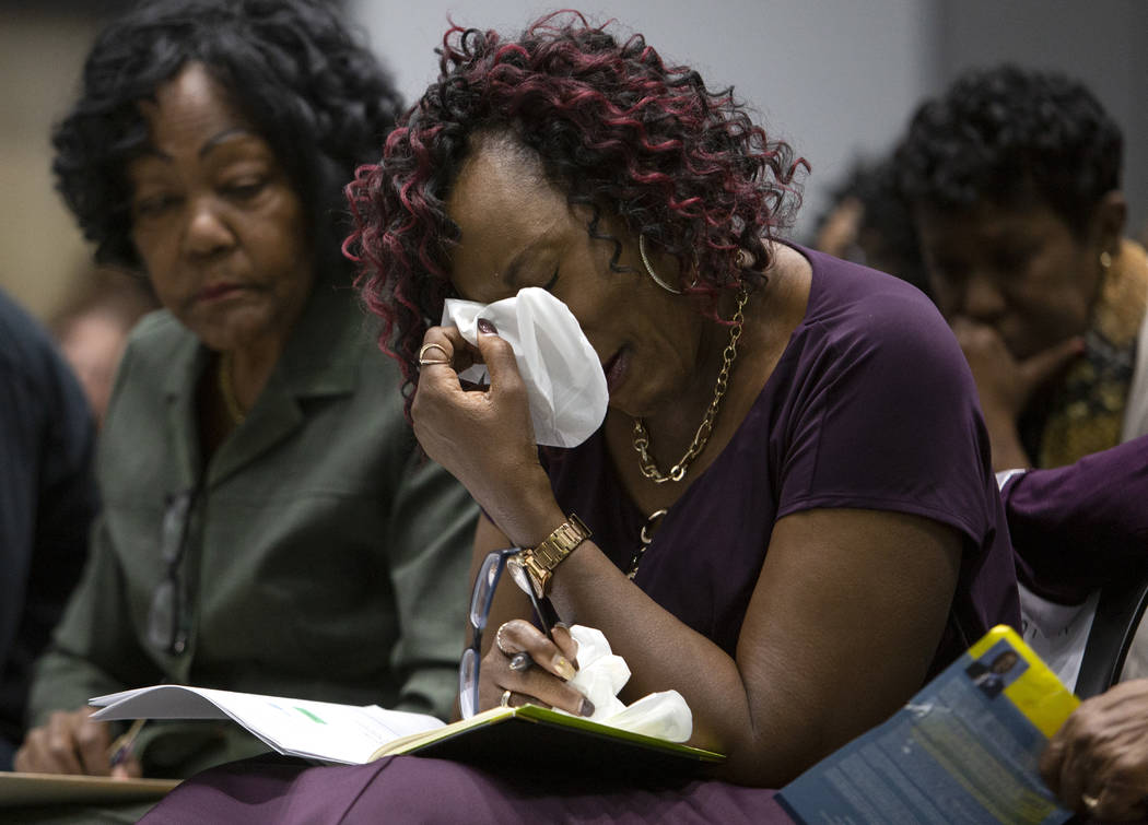 Sonja Mason, center, Tyrone Thompson's sister, is comforted by her aunt Bea Soares, left, at th ...