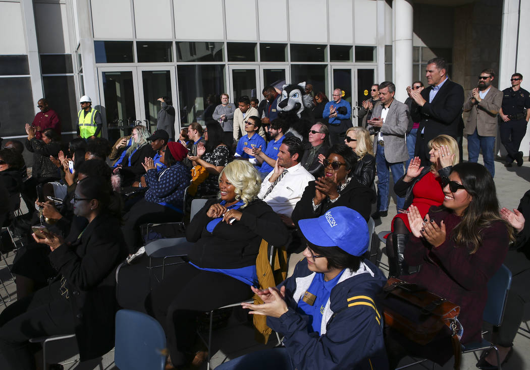 Attendees cheer during a topping off ceremony of the student union building at the College of S ...