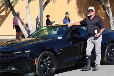 Jeff Henshaw was the winner of the first-ever hole-in-one grand prize, a Chevrolet Camaro spons ...