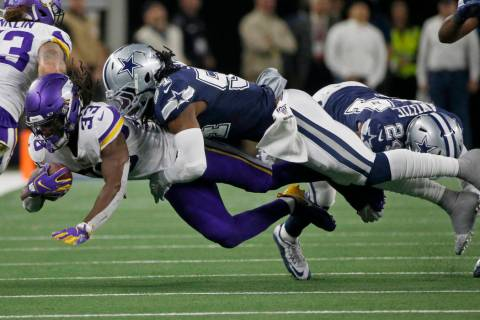 Minnesota Vikings running back Dalvin Cook (33) is tackled by Dallas Cowboys middle linebacker ...