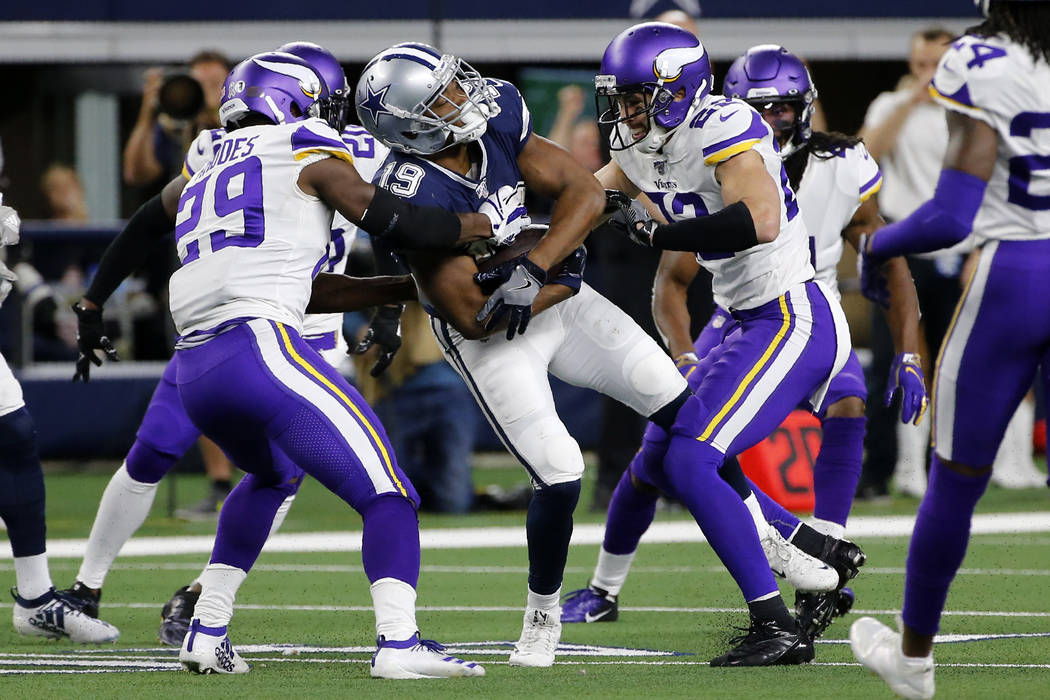 Dallas Cowboys wide receiver Amari Cooper (19) catches a pass and is stopped by Minnesota Vikin ...