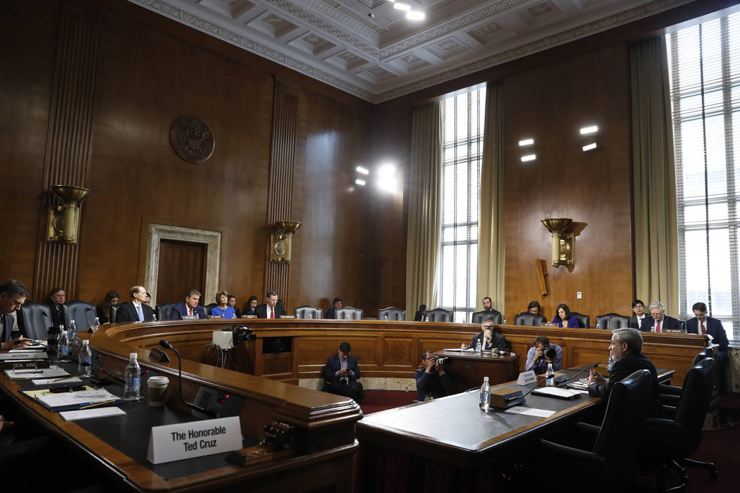 Secretary of Energy nominee Dan Brouillette, right, testifies during a Senate hearing on his no ...